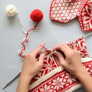 a womans hands fair isle knitting