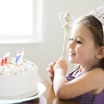 little girl with her birthday cake