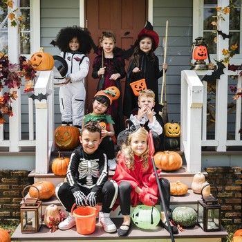 kids in different Halloween costumes