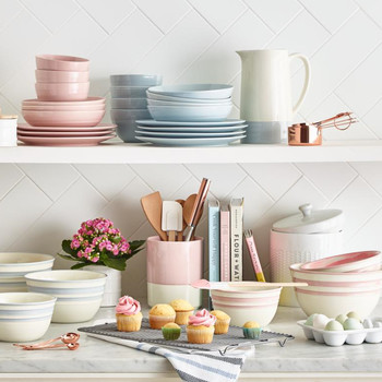 pink and blue pastel dinnerware on shelves