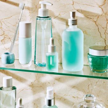 teal beauty products on bathroom shelf