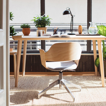 light brown wooden desk and chair set office space with various plants