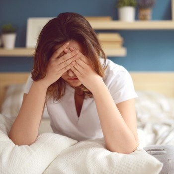 woman waking up unhappy
