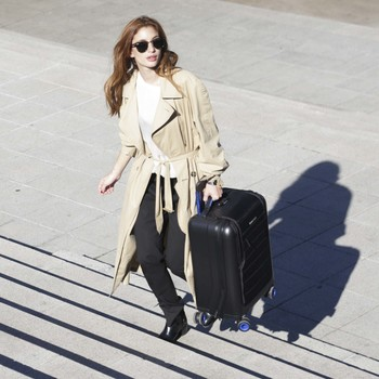 woman stairs smart suitcase bluesmart