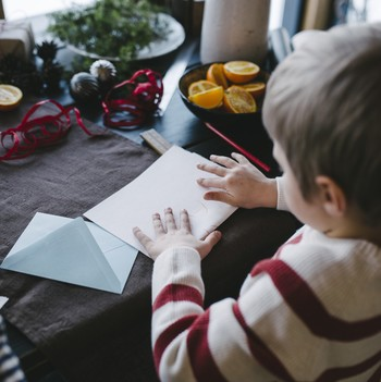 boy writing a letter to Santa