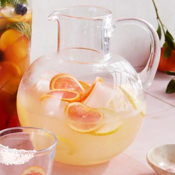 smoky lemon margarita in round glass pitcher