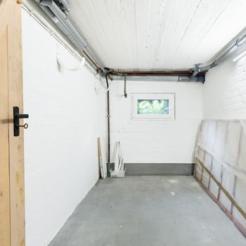 white wall unfinished basement