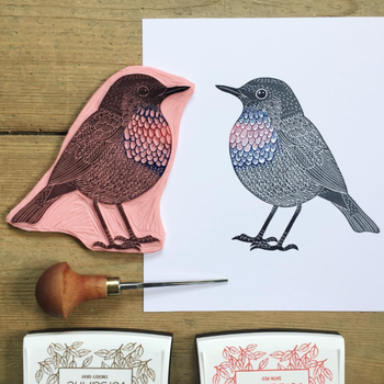 hand carved stamp of bird