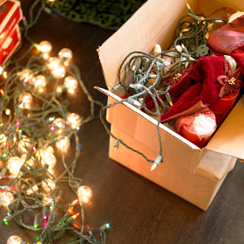 a box of string holiday lights on the floor