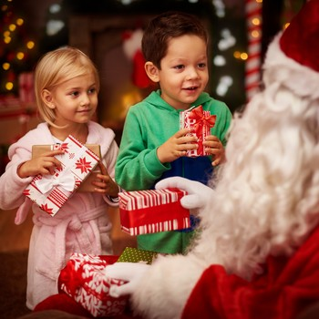Kids getting holiday gifts from Santa