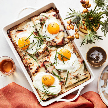 turkey-pastrami croque-madame casserole served in white dish