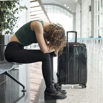 woman upset at airport