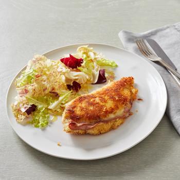 chicken cordon bleu on white plate
