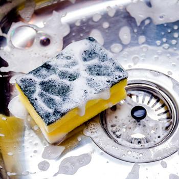 soap suds sponge cleaning kitchen sink