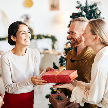 group of friends exchanging holiday gifts