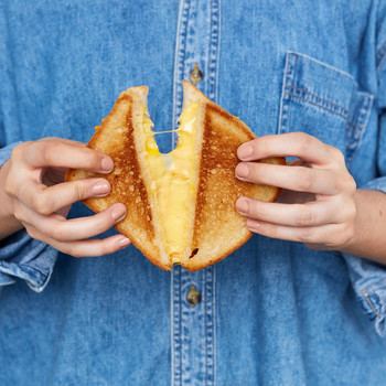 hands holding grilled cheese