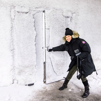 martha wearing winter gear opening door to svalbard global seed vault