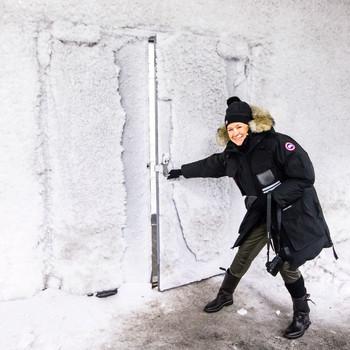 martha wearing winter gear opening door to svalbard global seed vault