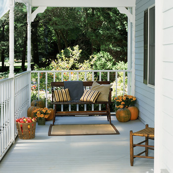 Wooden bench on front porch