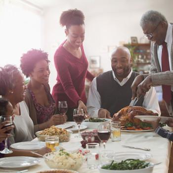 Family enjoying Thanksgiving meal