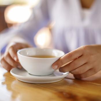 Woman holding and enjoying tea