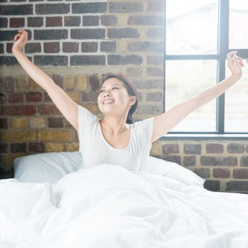 Woman waking up with big smile