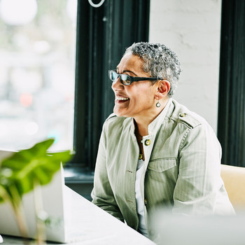 woman wearing glasses smiling