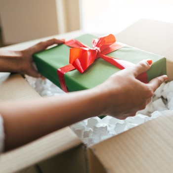 woman mailing a Christmas package of gifts