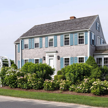 exterior of two-story nantucket beach house