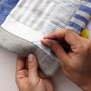 stitching a patchwork quilt