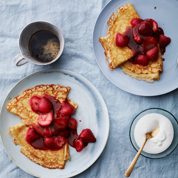 plated strawberry flambe crepes with coffee and cream