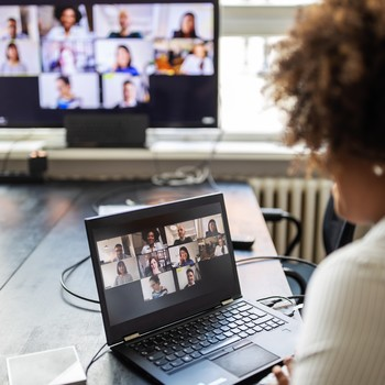 woman on a video conference meeting at office