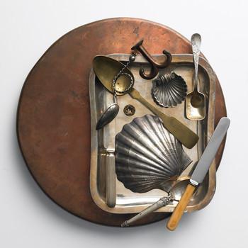 various metal trinkets displayed on tray