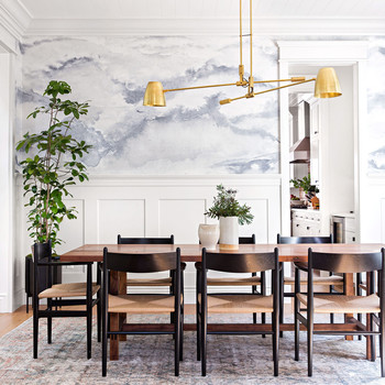 dining room with brass pendant light fixture