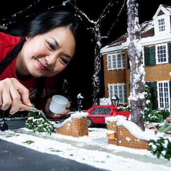 Michelle Wibowo working on Home Alone gingerbread house