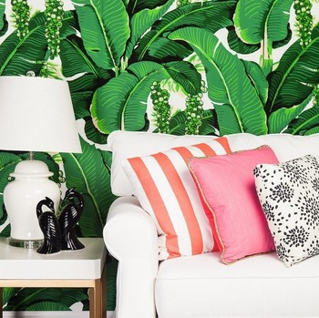greenery wallpaper with white couch and accent table