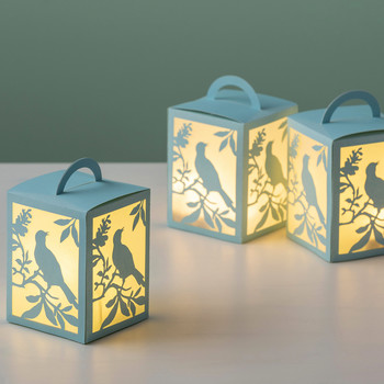 bird paper cut-out luminarias