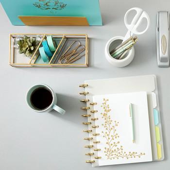 staples white gold notebooks on desk merch