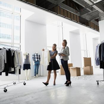 stylists examine blouse in studio