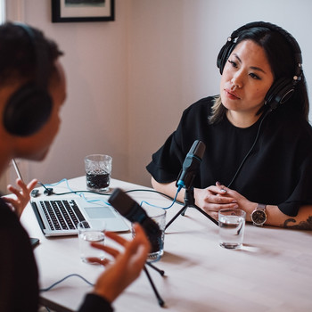woman recording podcast with interviewee