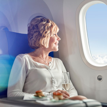 Woman Traveling in First Class on an Airplane