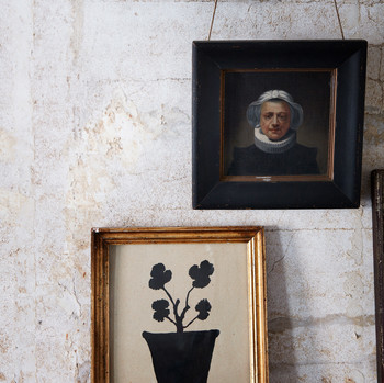 two pieces of wall art in John Derian's home