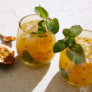 mango-passionfruit mojitos garnished with mint leaves