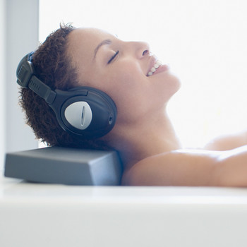woman headphones self care bath