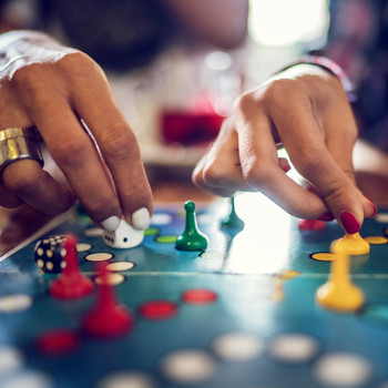 people playing board game