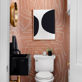 salmon and white geometric print bathroom walls