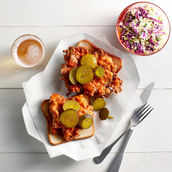 nashville-style hot chicken topped with pickles and served with coleslaw