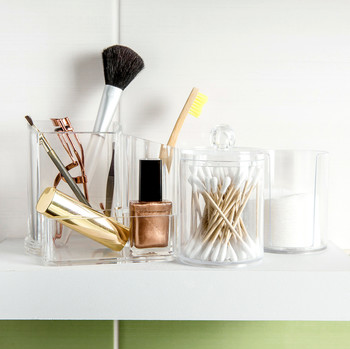 Makeup in plastic organizer on white shelf