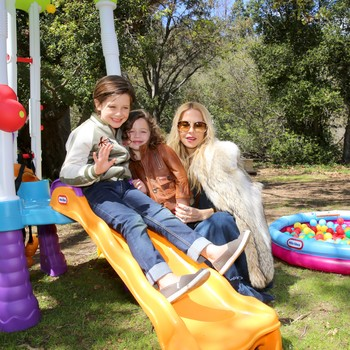 Rachel Zoe and her sons at a carnival birthday party