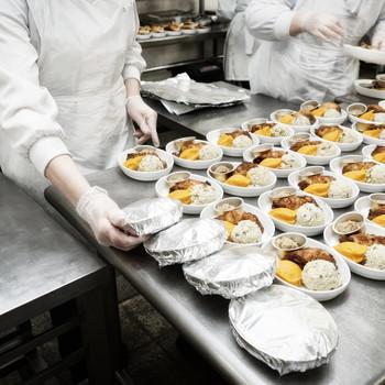 Chefs preparing meals for flights